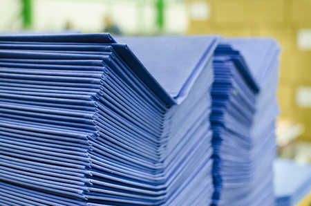 stapled: Many hard book covers stacked in a pile in offset pring production plant Stock Photo