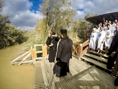 baptize: YERICHO, ISRAEL - 20 FEB, 2017: People are waiting to be baptized by water during a baptism ritual at Qasr el Yahud near Yericho on the Jordan river Editorial