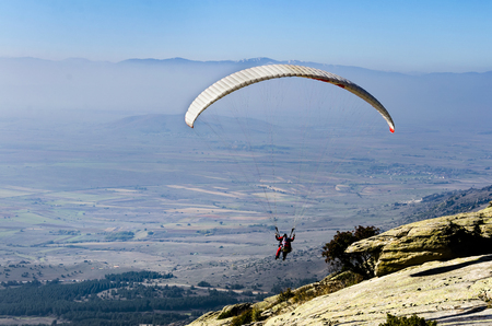 PRILEP, MACEDONIA - circa FEB, 2017: Paraglider taking off from a mountain