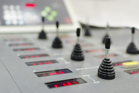 jobbing: Control panel of the equipment in a modern offset printing house. Registration unit joystick digital controler, selective focus Stock Photo