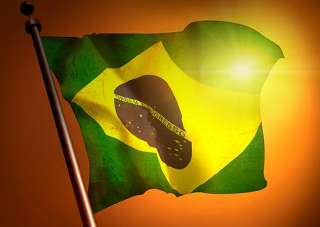 winner waving Brazil flag against the sunset