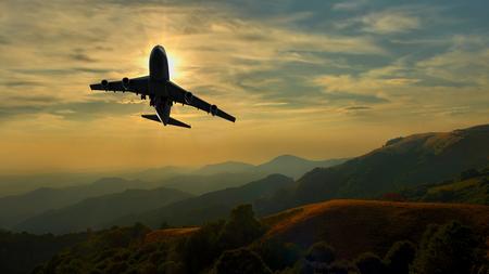 maneuvering: Commercial jet aeroplane maneuvering over mountain range