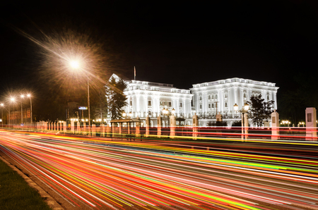 Government building in Skopje, Macedonia with light trails from night trafic Editorial