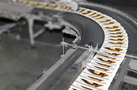 Stack of magazines on offset printing machine conveyor belt