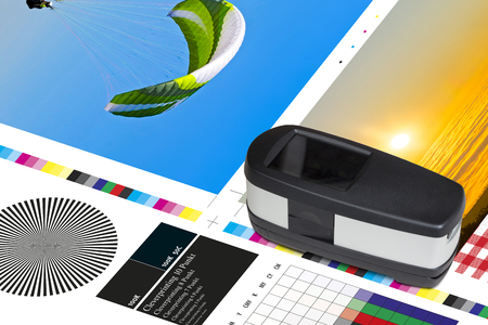 Offset print sheet color bar measurement. Spectrophotometer is electronic instrument for measuring of RGB, CMYK and LAB color values, printing controll