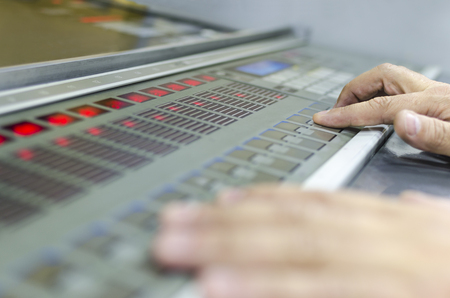 Hands on fountain key color management control unit. Offset machine press print run at table