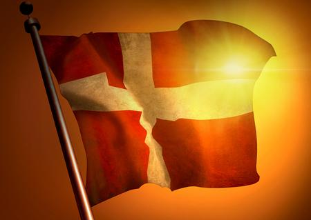 winner waving Denmark flag against the sunset