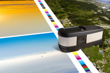 Print sheet with color bar measurement stroke. Spectrophotometer measure colors for offset printing control