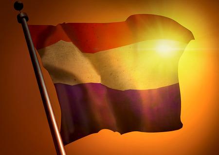 winner waving Netherlands flag against the sunset