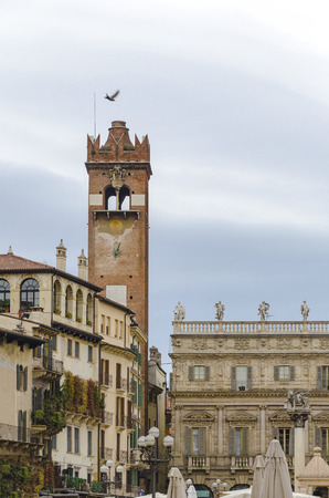 View of the Piazza delle Erbe in center of Verona city, Italy and Gardello tower in background (Market square)