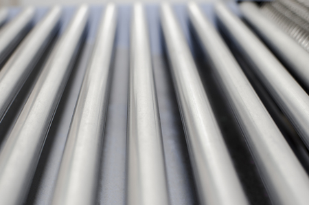 Roller conveyor in print plant, abstract background, selective focus