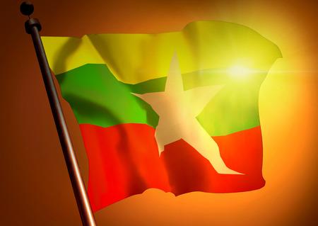 winner waving Burma flag against the sunset