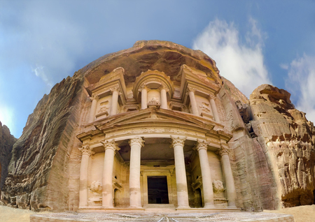 Low angle panoramic view of the facade of the Treasury building in the ancient Nabatean ruins of Petra, Jordan