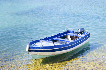 Fishing boat in shallow water