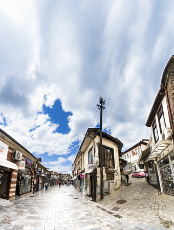 Ohrid, Macedonia - circa Jun, 2017: People walking on the the historical center of Ohrid town. Ohrid - is the most famous tourist destination in Macedoni, vertical