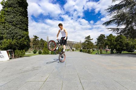 Skopje, Macedonia - circa Apr, 2013: BMX rider Exercising doing Tricks and Jumps Outdoors
