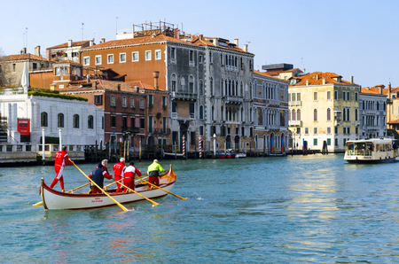 VENICE, ITALY - circa MAR, 2016: Rowing team durint training at Canal Grande in Venice, Italy Editorial
