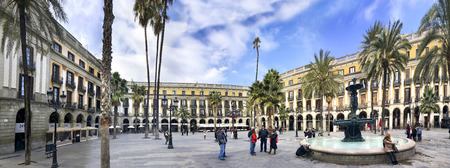 Panorama of  Plaza Real in Barcelona, Spain. The square, with lanterns designed by Gaudi and the Fountain of Three Graces in the center, has a lot of restaurants