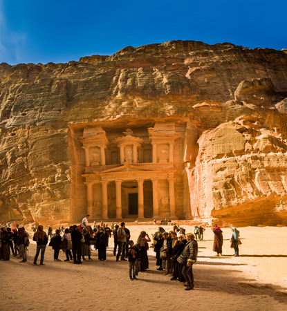 View of the facade of the Treasury building in the ancient Nabatean ruins of Petra, Jordan.