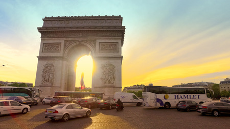 Arch Of Triumph And Champs Elysees Traffic Motion at Sunset