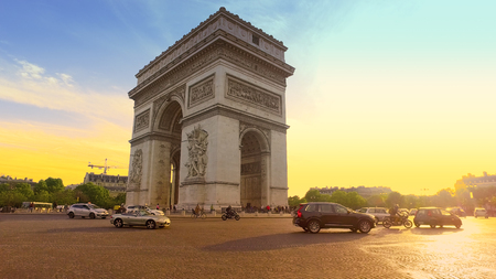 Sunset in Paris city with famous Arch de Triumph traffic circle panorama
