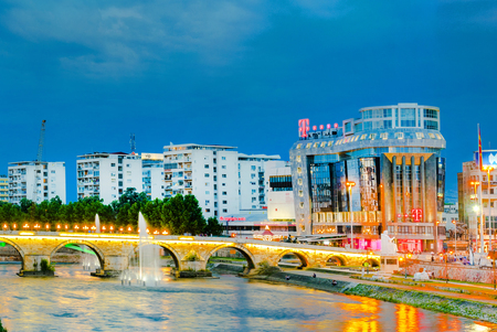 Skopje downtown illuminated at night with Stone Bridge, Vardar river and trade centar