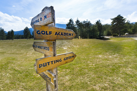Concept image of a signpost with golf course information on the arrows Stock Photo