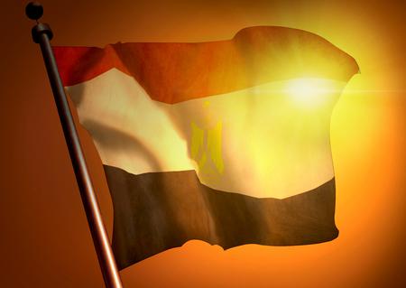 winner waving Egypt flag against the sunset