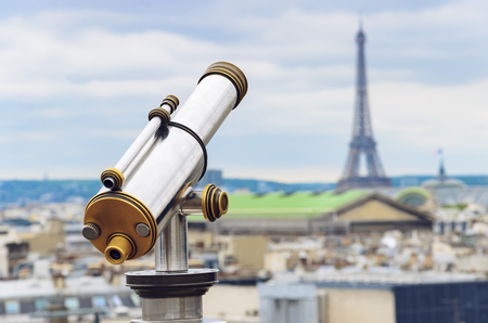 Tourist binocular telescope for Paris city observation from Lafayette gallery viewpoint to Eiffel tower