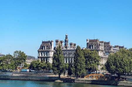 Panoramic view of Paris City Halll (Hotel de Ville) during spring sunny day. It was constructed in 1874 - 1882 by architects Theodore Ballou and Edouard Deperta