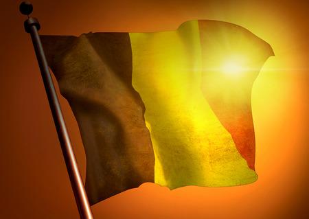 winner waving Belgium flag against the sunset