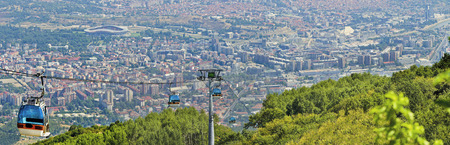 Panoramic view of Skopje and gondola cabin lift from Vodno mountain