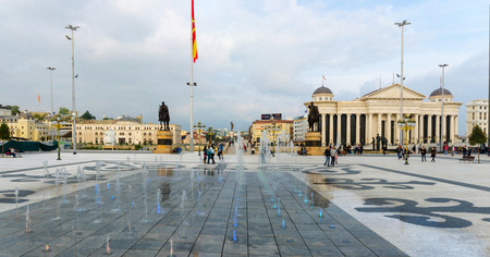 SKOPJE, MACEDONIA - circa NOE, 2016: Macedonia square in Skopje with dancing colorful fountains and Archeological museum and Stone Bridge