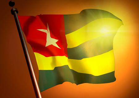 winner waving Togo flag against the sunset