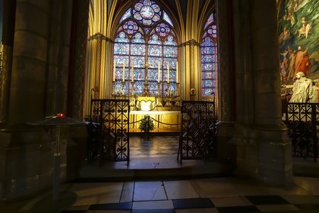 Small altar with six candles in Notre Dame at Paris, France