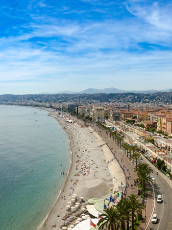 Luxury resort of French riviera. Beautiful panorama city of Nice in France. Sunny, summer day. Mediterranean sea, public beach, famous quay, palms and houses of Nice Standard-Bild - 109483644