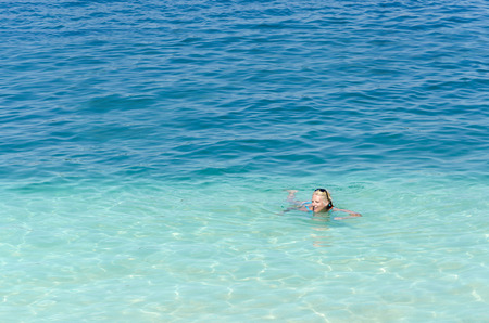 Woman swimming in open sea