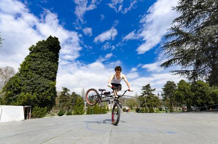 Skopje, Macedonia - circa Apr, 2013: A young man does a tricks on his BMX bike