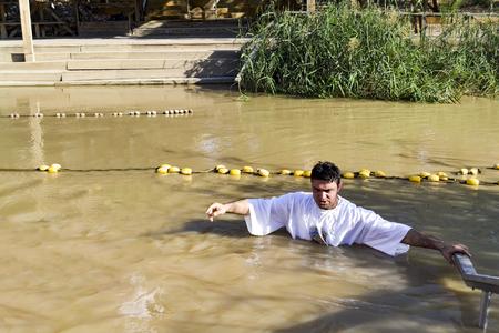 a man prays after his baptism in the Jordan Rive Stok Fotoğraf