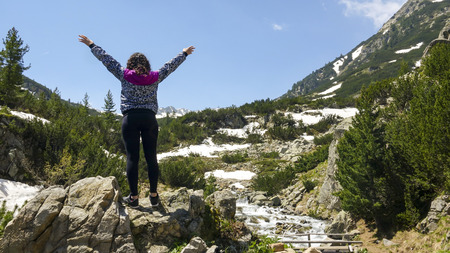 Sport Woman Excited Hold Hands Up Raised toward mountain showing Winner Concept Success Stok Fotoğraf