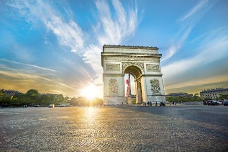 Paris Arc de Triomphe (Triumphal Arch) in Chaps Elysees at sunset, Paris, France. Architecture and landmarks of Paris. Postcard of Paris Editorial