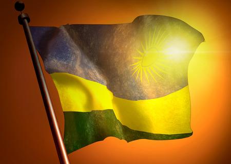 winner waving Rwanda flag against the sunset