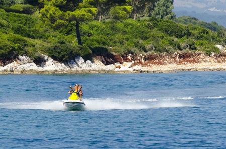 couple of people riding on a jet ski