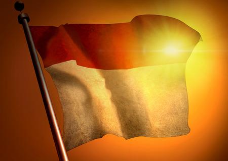 Winner waving Indonesia flag against the sunset
