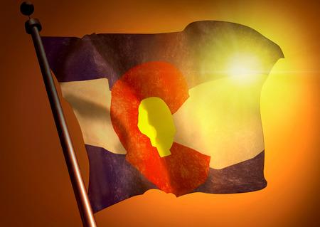winner waving Colorado flag against the sunset