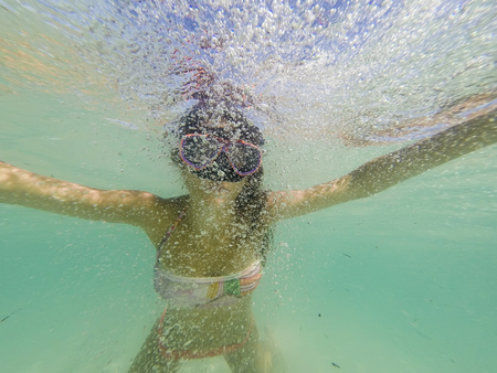 Young girl with snorkel mask underwater