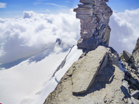 High mountain view to clouds, sky and summits at hiking expedition to Mont Blanc on Alps in France