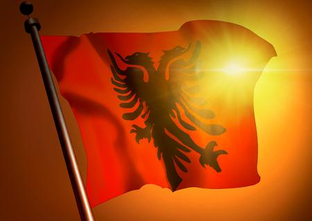 winner waving Albanian flag against the sunset