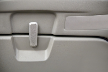 Airplane Tray Table, close-up of latch and tray