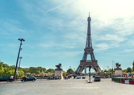 Traffic jam in Paris with veiw of Eiffel Tower at background during spring sunny day 写真素材